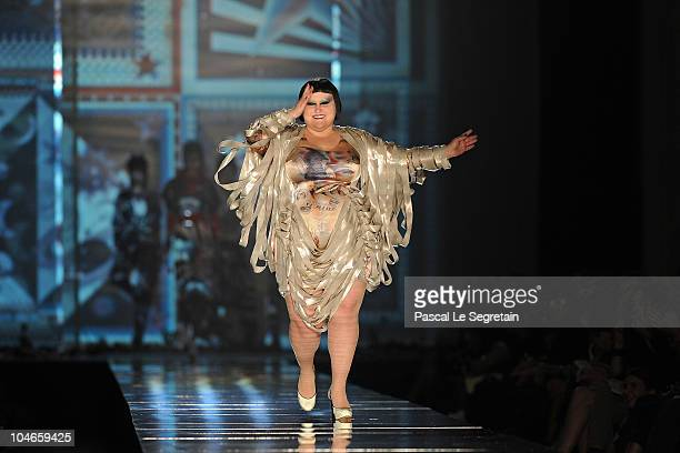 Beth Ditto walks the runway during the Jean Paul Gaultier Ready to Wear Spring/Summer 2011 show during Paris Fashion Week on October 2 2010 in Paris...