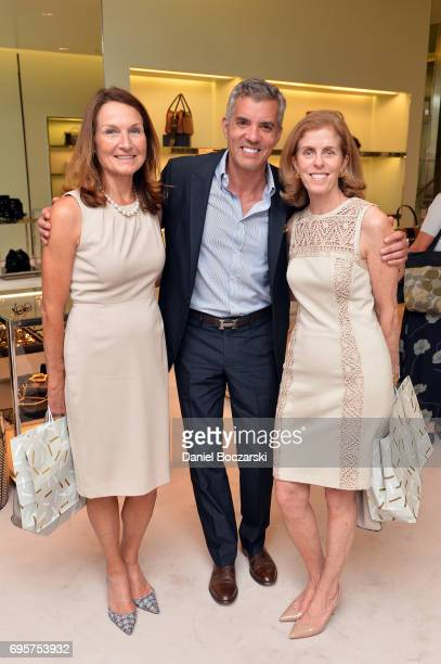 Beth Eugenio Jim Karas and Diane Reilly attend Prada Chicago x University Of Chicago Cancer Research Foundation Event at Prada Chicago on June 13...