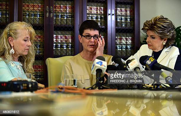 Beth Ferrier reacts while speaking seated between attorney Gloria Allred and Rebecca Lynn Neal on July 13 2015 in Los Angeles California where the...