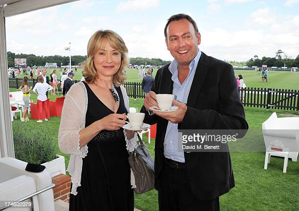 Beth Goddard and Philip Glenister attend the Audi International Polo at Guards Polo Club on July 28 2013 in Egham England