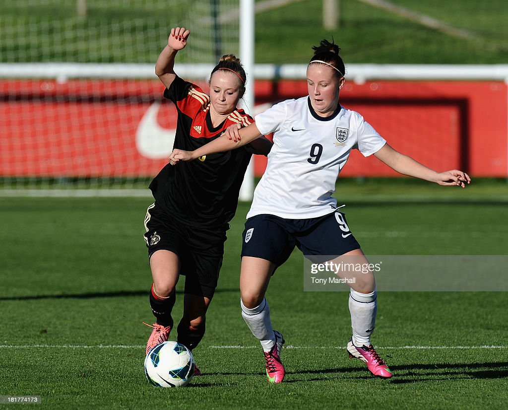 Beth Mead of England tackled by Judith Steinert of Germany during the Women's International Friendly match between England Under 19 Women and Germany Under 19 Women at St George's Park on September 22, 2013 in Burton upon Trent, England.