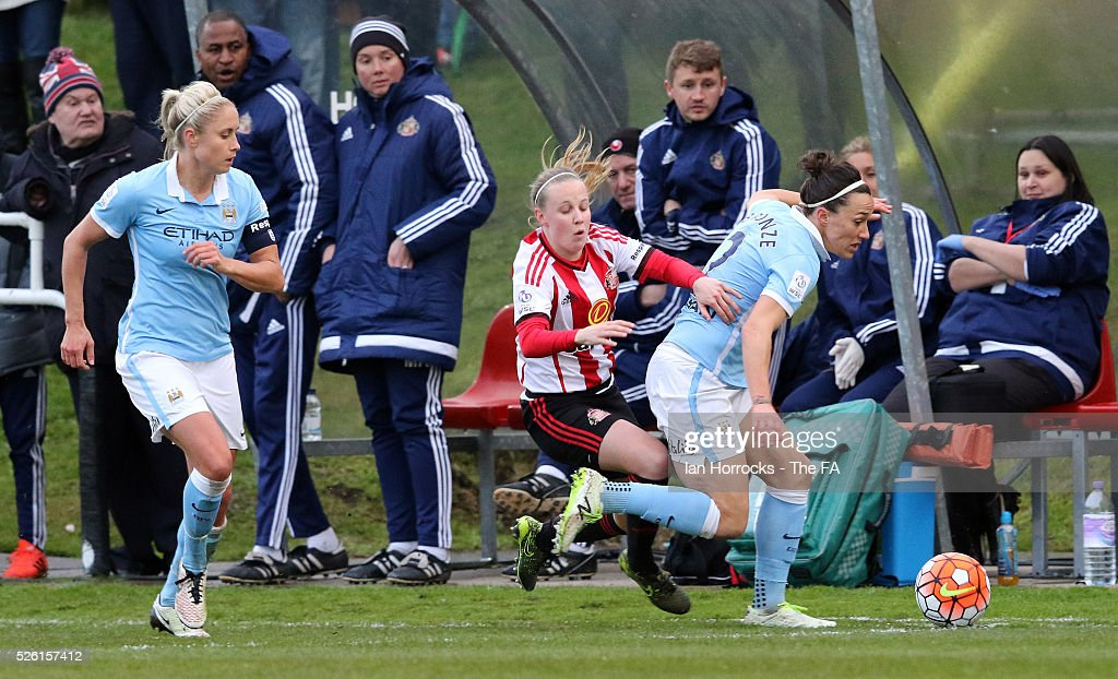 Beth Mead of Sunderland (C) gets sandwiched between Steph Houghton (L) and Lucy Bronze(R) during the WSL 1 match between Sunderland AFC Ladies and Manchester City Women at The Hetton Center on April 29, 2016 in Hetton, England.