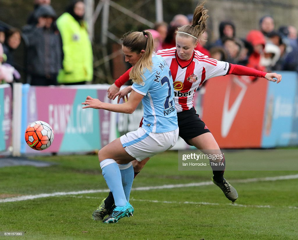Beth Mead of Sunderland (R) tries to get past Abi McManus of City during the WSL 1 match between Sunderland AFC Ladies and Manchester City Women at The Hetton Center on April 29, 2016 in Hetton, England.