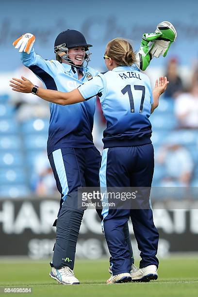 Beth Mooney and Danielle Hazell of Yorkshire celebrate the dismissal of Ellyse Perry of Loughborough during the inaugural Kia Super League women's...