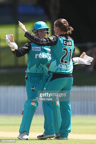 Beth Mooney and Jess Jonassen of the Heat celebrate dismissing Rachel Priest of the Renegades during the Women's Big Bash League match between the...
