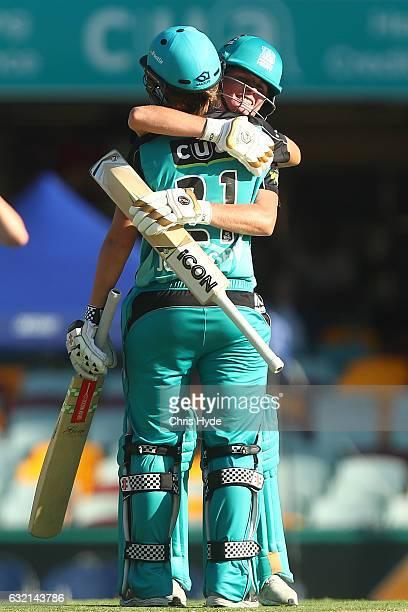 Beth Mooney and Jessica Jonassen of the Heat celebrate winning the Women's Big Bash League match between the Brisbane Heat and the Adelaide Strikers...