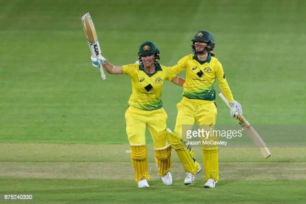 Beth Mooney and Rachael Haynes of Australia celebrate winning during the first Women's Twenty20 match between Australia and England at North Sydney...