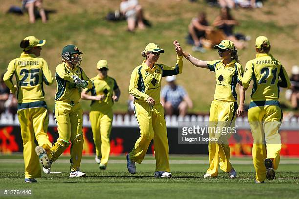 Beth Mooney of Australia celebrates after taking a catch to dismiss Suzie Bates of New Zealand during match one of the TransTasman Twenty20 Series at...
