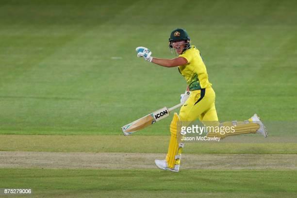 Beth Mooney of Australia celebrates hitting the winning runs during the first Women's Twenty20 match between Australia and England at North Sydney...