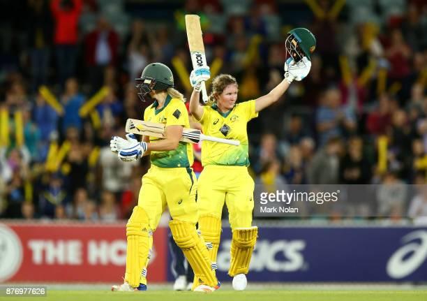 Beth Mooney of Australia celebrates scoring a century during the Third Women's Twenty20 match between Australia and England at Manuka Oval on...