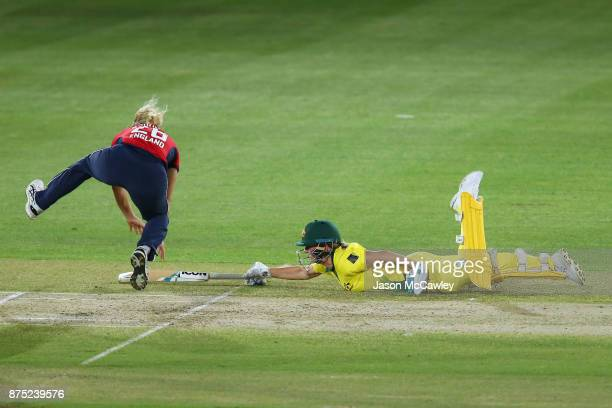 Beth Mooney of Australia dives to avoid been run out during the first Women's Twenty20 match between Australia and England at North Sydney Oval on...