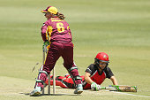 Beth Mooney of the Fire attempts a runout of Bridget Patterson of the Scorpions during the WNCL match between South Australia and Queensland at...