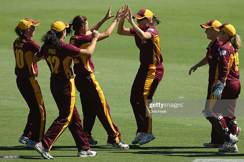 Beth Mooney of the Fire celebrates after taking a catch to dismiss Renee Farrell of the Metoers during the WT20 match between Queensland Fire and the...