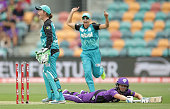 Beth Mooney of the Heat celebrates after taking the wicket of Heather Knight of the Hurricances by a runout during the Women's Big Bash League match...