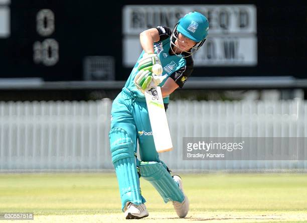 Beth Mooney of the Heat hits the ball to the boundary for a four during the WBBL match between the Heat and Stars at Allan Border Field on December...