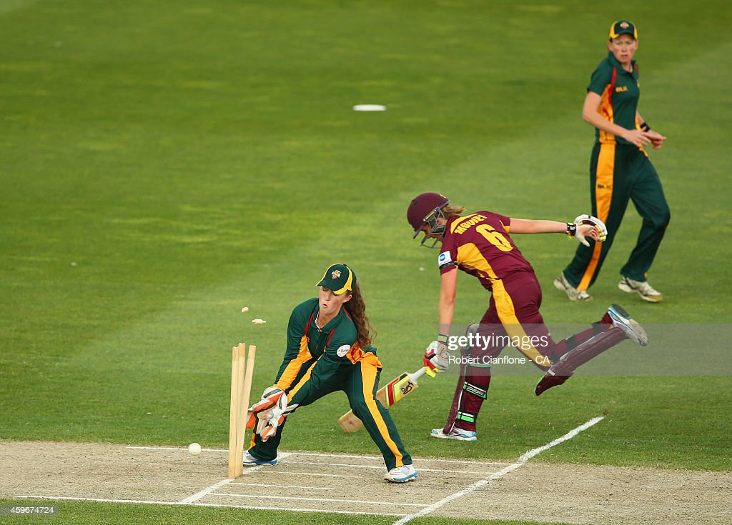 Beth Mooney of the Queensland Fire survives a run out during the WT20 match between Tasmania and Queensland Aurora Stadium on November 28 2014 in...