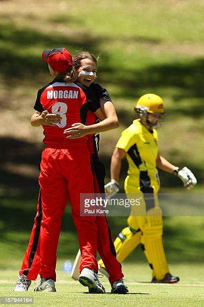 Beth Morgan and Alex Price of the Scorpions celebrate the wicket of Nicola Shaw of the Fury during the WNCL match between the Western Australia Fury...