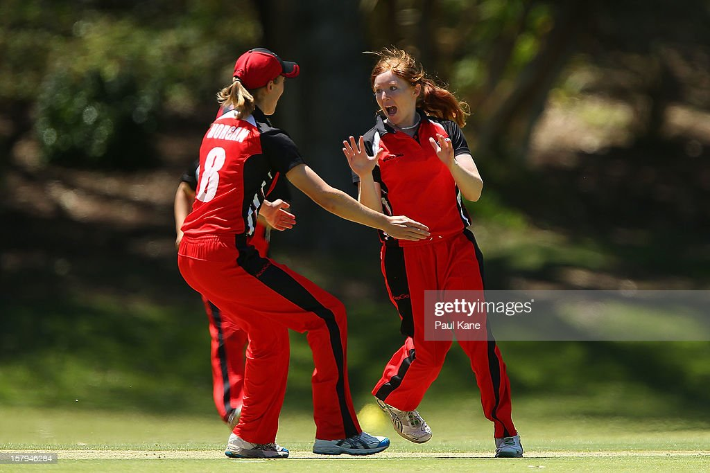 Beth Morgan and Kiara Stockley of the Scorpions celebrate the wicket of Jenny Wallace of the Fury during the WNCL match between the Western Australia Fury and the South Australia Scorpions at Christ Church Grammar Playing Fields on December 8, 2012 in Perth, Australia.