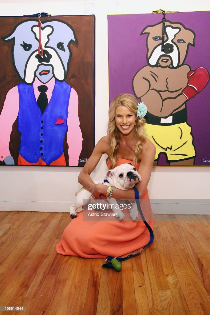 <a gi-track='captionPersonalityLinkClicked' href=/galleries/search?phrase=Beth+Ostrosky&family=editorial&specificpeople=212785 ng-click='$event.stopPropagation()'>Beth Ostrosky</a> Stern poses for photos with bulldog 'Gordy' at the Chris Collins 'Top Dogs' VIP Reception on May 16, 2013 in New York, United States.
