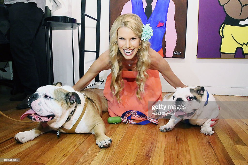 Beth Ostrosky Stern poses for photos with bulldogs 'Baby Howard' and 'Gordy' at the Chris Collins 'Top Dogs' VIP Reception on May 16, 2013 in New York, United States.