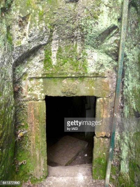 Beth She'arim, a little door covered with moss, adorned with a trifle leading to a burying cave