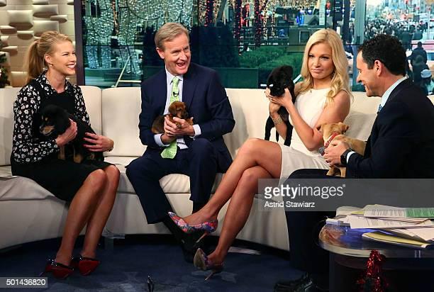Beth Stern Steve Doocy Anna Kooiman Brian Kilmeade and four furry friends from the North Shore Animal League appear on 'Fox Friends' at FOX Studios...
