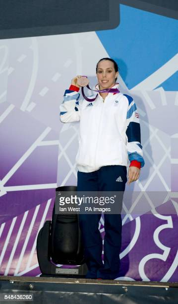 Beth Tweddle shows off her Bronze Medal won in the Women's Uneven Bars Final at BT London Live a series of outdoor concerts to celebrate the Olympic...