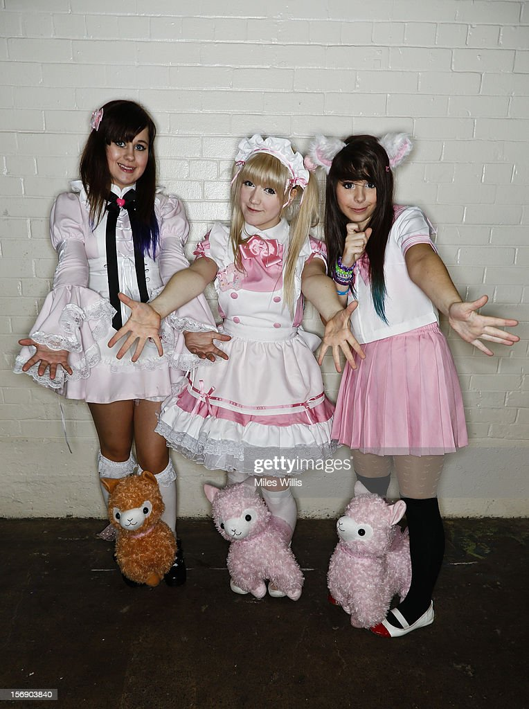 Beth Weal, Abi Pop and Jelly Neko (fictional names) from Sussex in 'Schoolgirl' fashion at Hyper Japan at Earl's Court on November 24, 2012 in London, England. Hyper Japan is the UK's biggest Japanese culture event with many of the visitors dressing as cosplay, anime and manga characters.