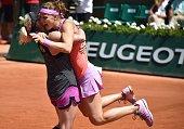 US Bethanie MattekSands and Czech Republic's Lucie Safarova celebrate after winning against Australia's Casey Dellacqua and Kazakhstan's Yaroslava...