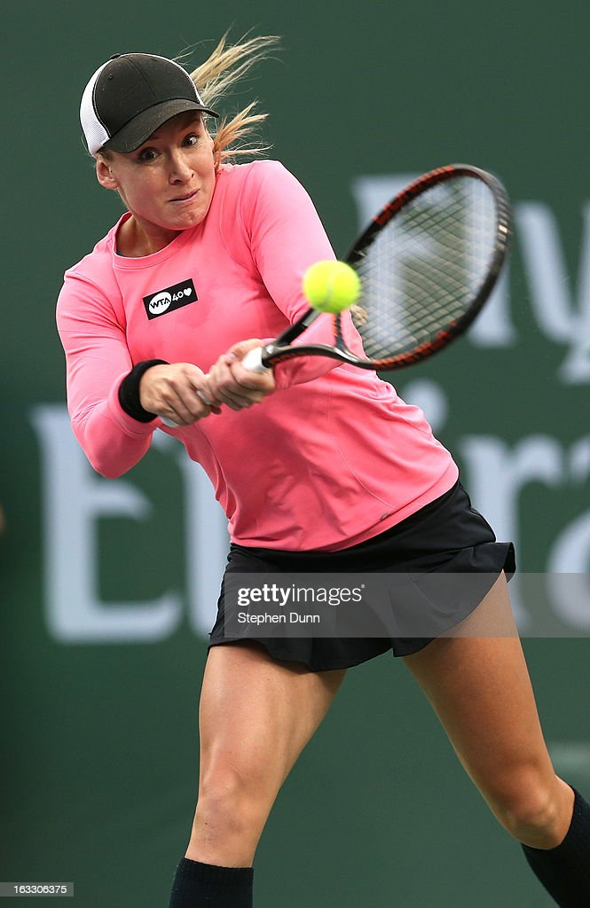 Bethanie Mattek-Sands hits a return to Jamie Hampton during day 2 of the BNP Paribas Open at Indian Wells Tennis Garden on March 7, 2013 in Indian Wells, California.