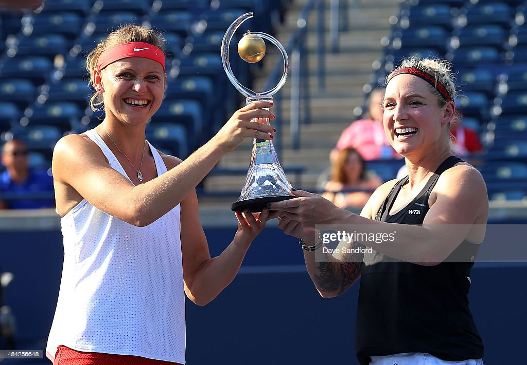 <a gi-track='captionPersonalityLinkClicked' href=/galleries/search?phrase=Bethanie+Mattek-Sands&family=editorial&specificpeople=7481266 ng-click='$event.stopPropagation()'>Bethanie Mattek-Sands</a> (black top) of the United States and Lucie Safarova of the Czech Republic hold the doubles championship trophy after defeating Caroline Garcia of France & Katarina Srebotnik of Slovania during the doubles final on Day 7 of the Rogers Cup at the Aviva Centre on August 16, 2015 in Toronto, Ontario, Canada.