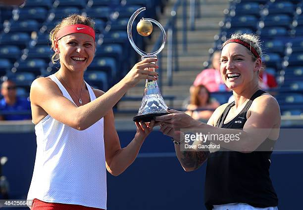 Bethanie MattekSands of the United States and Lucie Safarova of the Czech Republic hold the doubles championship trophy after defeating Caroline...