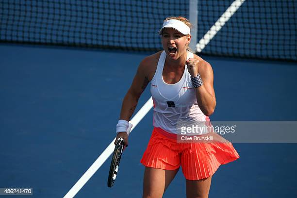 Bethanie MattekSands of the United States reacts against Coco Vandeweghe of the United States during their Women's Singles Second Round match on Day...