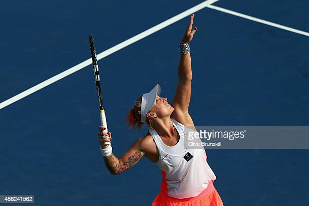 Bethanie MattekSands of the United States serves against Coco Vandeweghe of the United States during their Women's Singles Second Round match on Day...