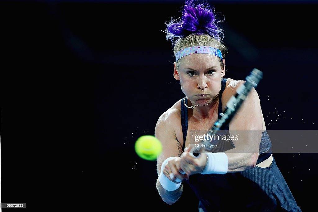 Bethanie Mattek-Sands of the USA plays a backhand during day one of the 2014 Brisbane International at Queensland Tennis Centre on December 29, 2013 in Brisbane, Australia.