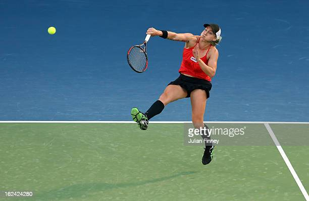 Bethanie MattekSands of USA plays a smash as Sania Mirza of India in action in their doubles final match against Nadia Petrova of Russia and Katerina...