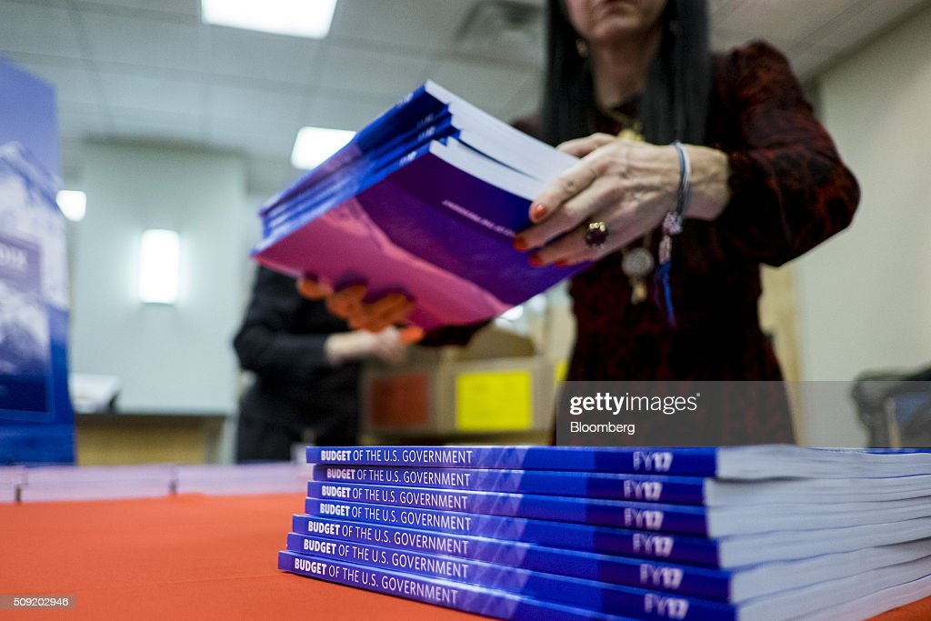 BethAnn Telford, special events coordinator with the Government Printing Office, arranges copies of U.S. President Barack Obama's Fiscal Year 2017 Budget for sale at the Government Publishing Office bookstore in Washington, D.C., U.S., on Tuesday, Feb. 9, 2016. Obama will send a fiscal 2017 budget of about $4 trillion to the Republican-controlled Congress on Tuesday representing his aspirations for the future of the U.S. Photographer: Pete Marovich/Bloomberg via Getty Images