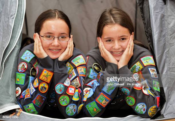 Bethany and Abby Williams twin sisters from Gravesend in Kent show off their 45 Badges and Awards for Guiding at the Girl Guides UK Headquarters in...