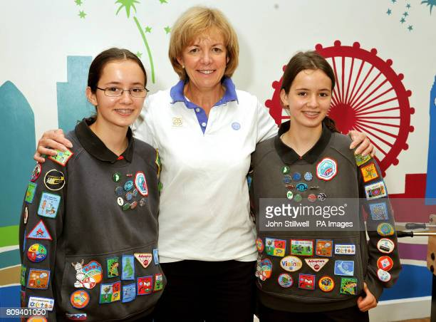 Bethany and Abby Williams twin sisters from Gravesend in Kent with Chief Guide for the UK Gill Slocombe show off their 45 Badges and Awards for...