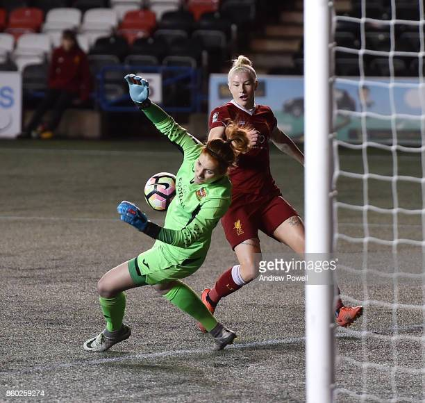 Bethany England of Liverpool Ladies has her shot saved by Danielle Gibbons of Sheffield FC Ladies during the Women's Super League match between...