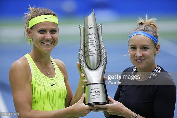 Bethany Mattek Sands of USA and Lucie Safarova of Czech pose for a picture with their trophy on day 7 of 2016 Dongfeng Motor Wuhan Open at Optics...
