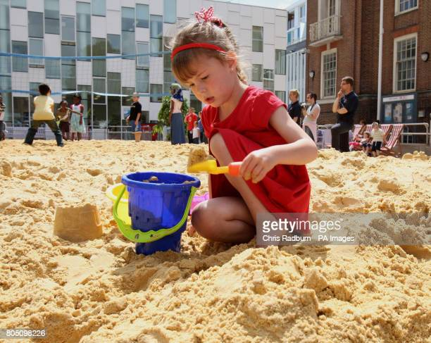 Bethany Rushbrooke from Dagenham Essex enjoys the beach in the Town Square of Barking Essex inspired by the Olympics and celebrating the birthday of...