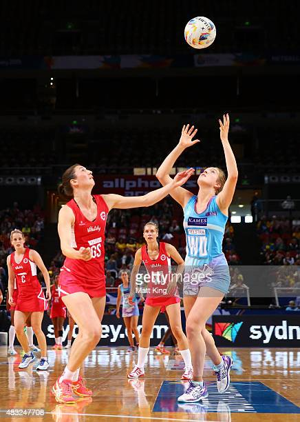 Bethany Sutherland of Scotland is challenged by Rachel Dunn of England during the 2015 Netball World Cup match between England and Scotland at...
