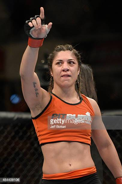 Bethe Correia celebrates after defeating Shayna Baszler in their women's bantamweight fight at UFC 177 inside the Sleep Train Arena on August 30 2014...