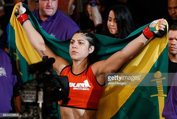 Bethe Correia of Brazil enters the arena before her women's bantamweight bout against Shayna Baszler during the UFC 177 event at Sleep Train Arena on...