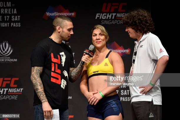 Bethe Correia of Brazil is interviewed by Dan Hardy on stage during the UFC Fight Night weighin at the Marina Bay Sands on June 16 2017 in Singapore