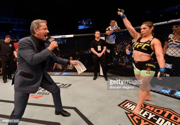 Bethe Correia of Brazil is introduced by Bruce Buffer prior to her women's bantamweight bout against Holly Holm during the UFC Fight Night event at...