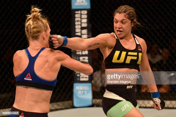 Bethe Correia of Brazil lands a spinning back fist against Holly Holm in their women's bantamweight bout during the UFC Fight Night event at the...