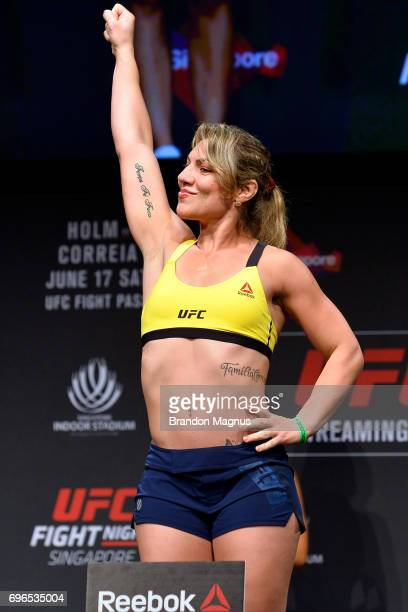 Bethe Correia of Brazil poses on the scale during the UFC Fight Night weighin at the Marina Bay Sands on June 16 2017 in Singapore
