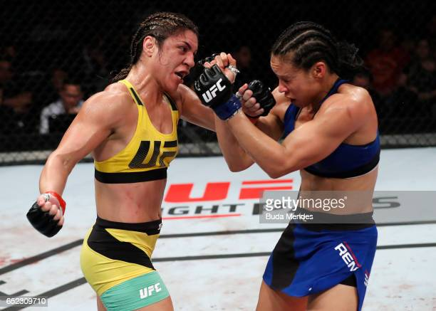 Bethe Correia of Brazil punches Marion Reneau in their women's bantamweight bout during the UFC Fight Night event at CFO Centro de Formaco Olimpica...